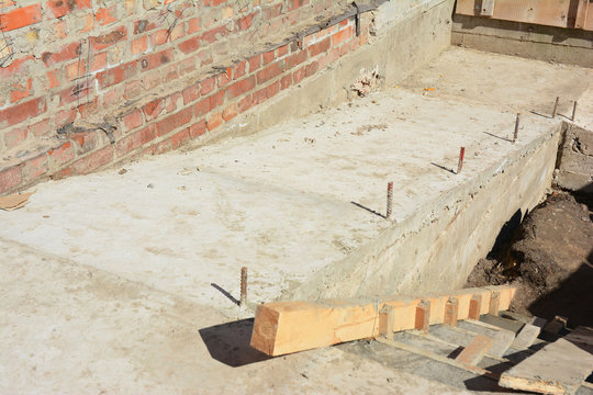 Building ramp for wheelchair entry and steps. Brick ramp way for support wheelchair disabled people in new house construction. Concrete ramp for wheelchair entry and steps construction.