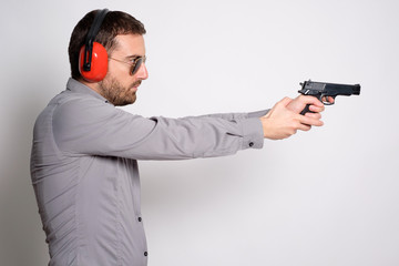 Man holding a gun in hands ready to shoot