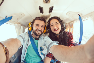 Young couple in airplane