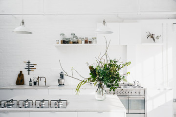Bright kitchen with industrial and minimal finishes