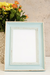 White Frame Mock Up. Rustic vase with roses. White background, empty place.  Vintage tinted