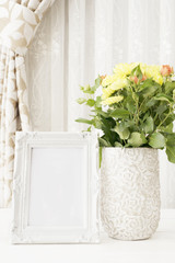 White Frame Mock Ups, Digital MockUp, Display Mockup, Colorful Desktop Mock Up. Rustic vase with orange roses and yellow chrysanthemums. White background, empty place, copy space. Vintage tinted