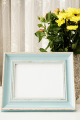 Sea Blue Frame Mock Ups, Digital MockUp, Display Mockup, Colorful Desktop Mock Up. Rustic vase with orange roses and yellow chrysanthemums. White background, empty place, copy space. Vintage tinted