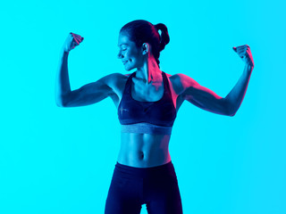 one mixed races muscular woman exercsing fitness exercices isolated on blue blackground