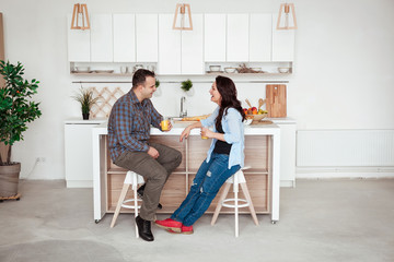 Romantic young couple having breakfast in the kitchen