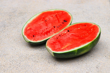 watermelon red fresh half  on polished stone table select focus with shallow depth of field.