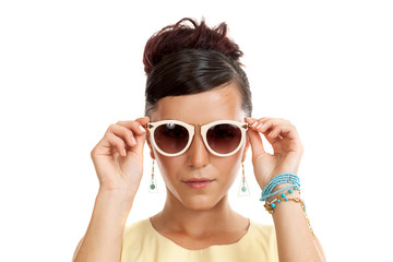 the young woman in sunglasses