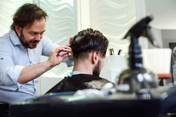 Handsome man at fashion stylist hair saloon