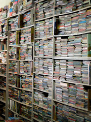 COLOR PHOTO OF BOOKS CRAMMED IN BOOKSHELVES AT BOOKSTORE