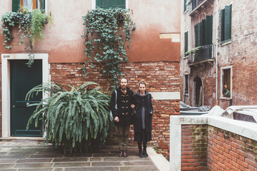 Portrait of couple in courtyard, Venice, Italy