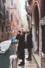 Couple taking pictures in old town