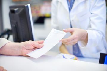 Close up of patient with prescription .