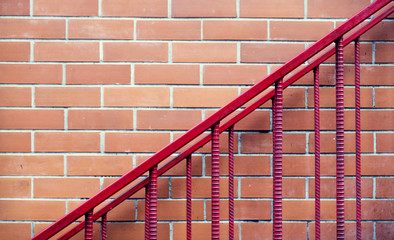 Red brick wall texture and railing to go upstairs