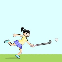 Female hockey player on grass