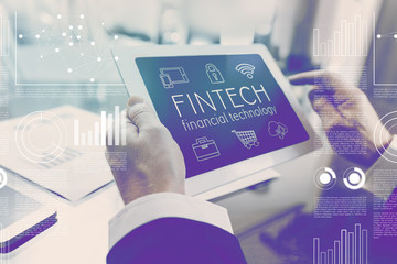 Financial technology fintech concept businessman using digital tablet
