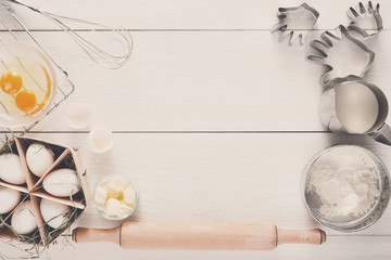 Baking ingredients on white rustic wood background, copy space