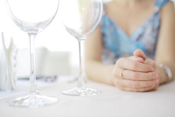 glasses on the table serving restaurant light background girl