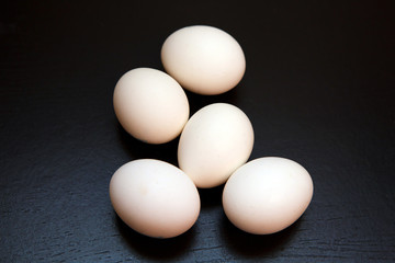 White chicken eggs. Natural rustic food that gave birth to birds. Easter still life egg clean.