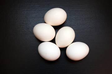 White chicken raw eggs. Natural rustic food that gave birth to birds. Easter still life egg clean.