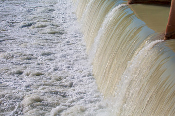 Strong stream of water at the hydroelectric dam