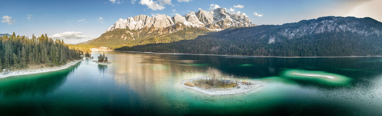 Printed roller blinds Reflection Landscape scenery with a island in the foreground on an alpine lake and the Zugspitze in the background