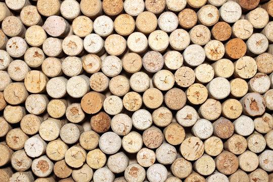 Wine corks background horizontal / used wine corks / many wine corks / closeup of a wall of used wine corks