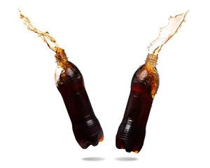 Couple cola splashing out of bottle Isolated on white background.