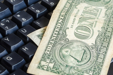 One Dollar banknotes on a computer keyboard