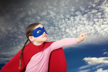 Cute little super hero girl in the red cloak. Superhero concept