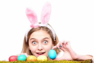 happy easter girl in bunny ears with colorful painted eggs