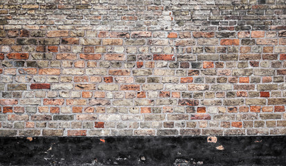 Old brick wall with black stripe, flat texture