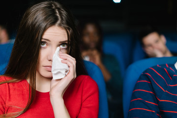 Young woman crying at the movies