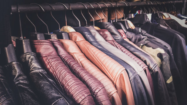 Collection of leather jackets on hangers in the shop for biker's or motorcycle jackets.