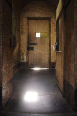 old style prison door and window with lens flare