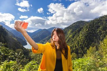 Young beautiful long hair woman making emotional selfi