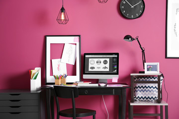 Modern designer workplace with computer and stationery