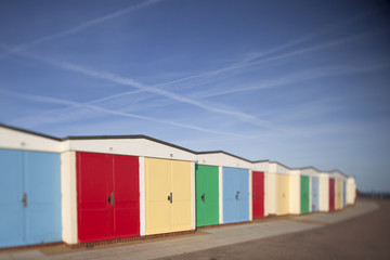 A row of colourful beach huts on the seafront at Exmouth, Devon, UK