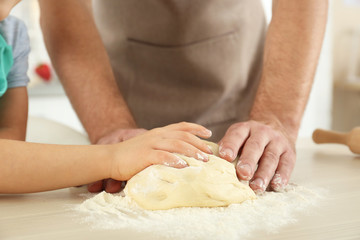 Father and son cooking together, closeup