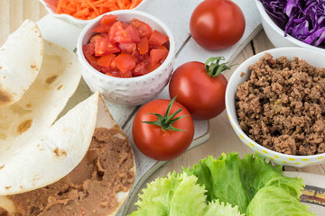 Ingredients for homemade taco salad with spicy beef, refried beans.