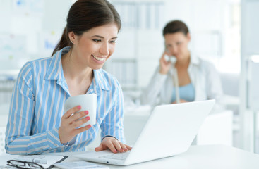Business woman sitting with laptop