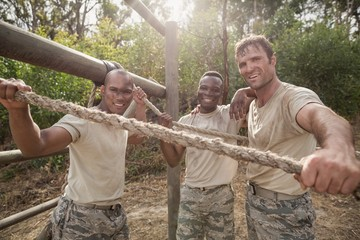 Portrait of military soldiers smiling during obstacle training