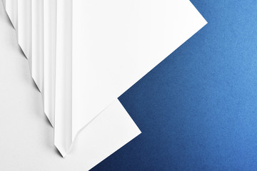 Abstract paper origami background in blue and white