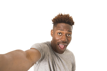 young afro american man smiling happy taking selfie self portrait picture with mobile phone