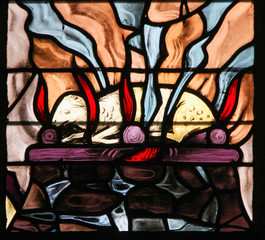 Wall Mural - Stained Glass of a burning lamb, symbolizing the Agnus Dei