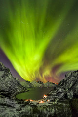 Aurora borealis (Polar lights) over the mountains in the North of Europe - Senja island, Troms county, Norway