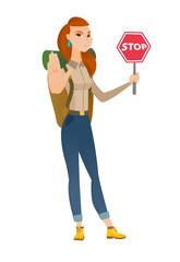 Caucasian traveler holding stop road sign.