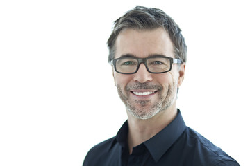 Portrait Of A Handsome Man Smiling At The Camera. Isolated On White. With Glasses.