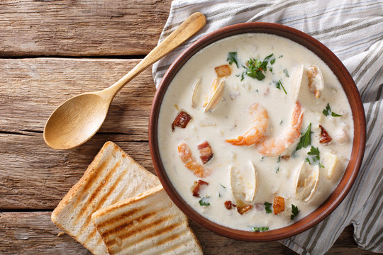 American cuisine: New England clam chowder soup closeup. horizontal top view