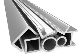 Shiny rolled metal steel products on white