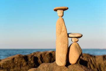 Symbolic figurines on coast